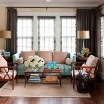 Blues and Browns Mixed Up with Coral to Freshen the Style in a Living Room Image